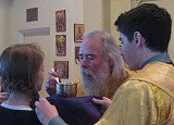 Holy Communion was distributed to the faithful by His Eminence, Archbishop Job