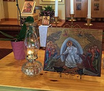 The Holy Fire from the Lord's Tomb in Jerusalem was brought to St Herman's and burns on our altar and on our