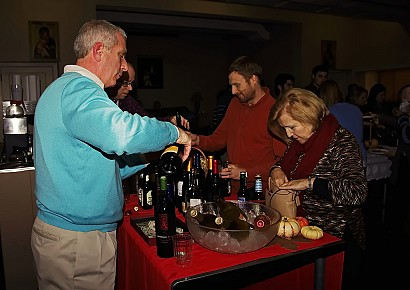 Joe pours out a good wine to bring out a really good meal!